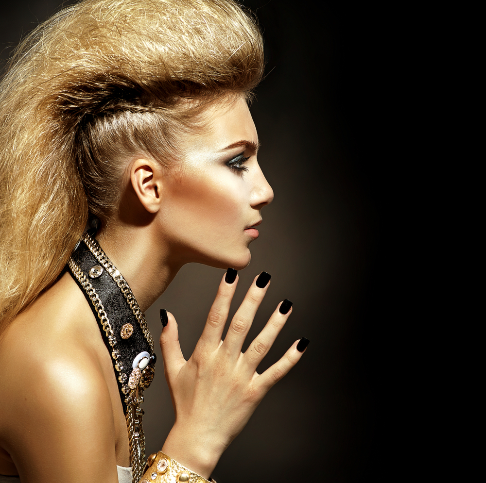 A woman with unique hair and a leather choker