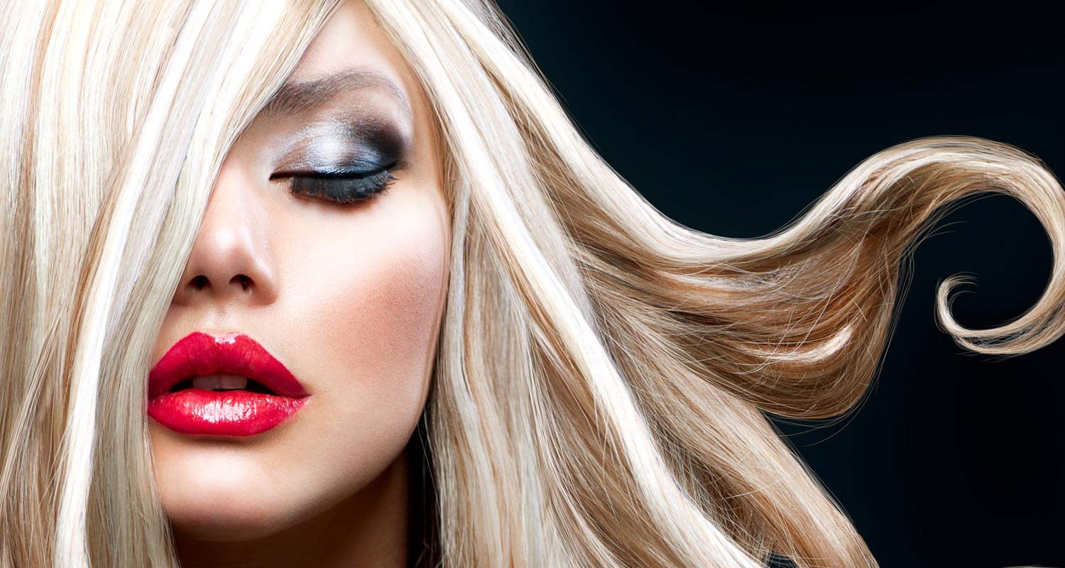 Blonde woman with dark makeup and red lipstick