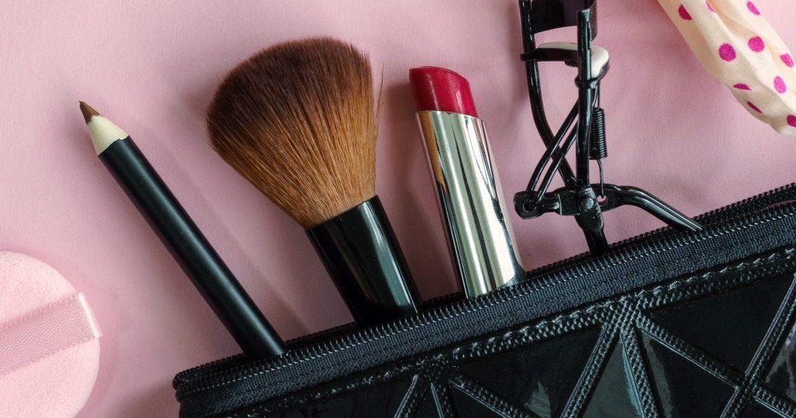 Makeup tools coming out of a makeup bag