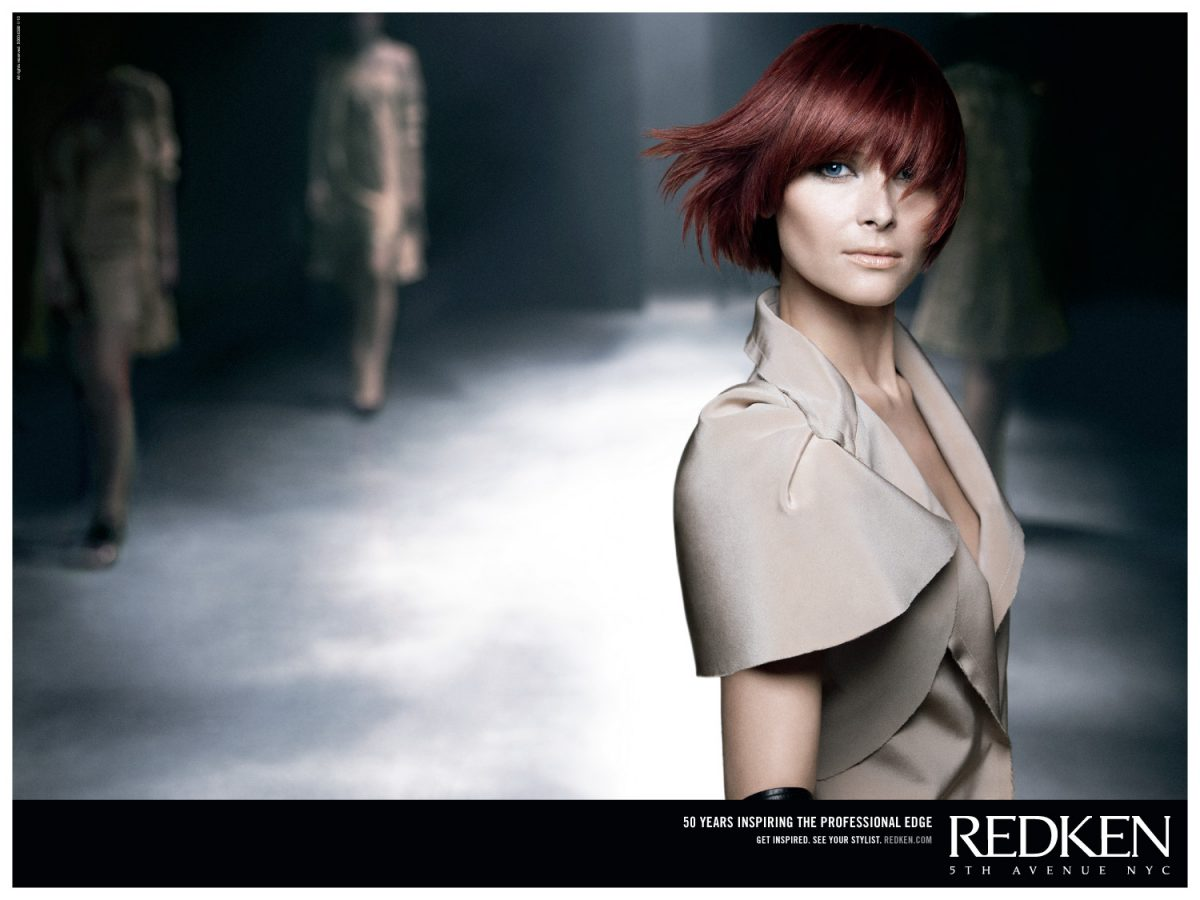 A redhaired Redken model struts the runway