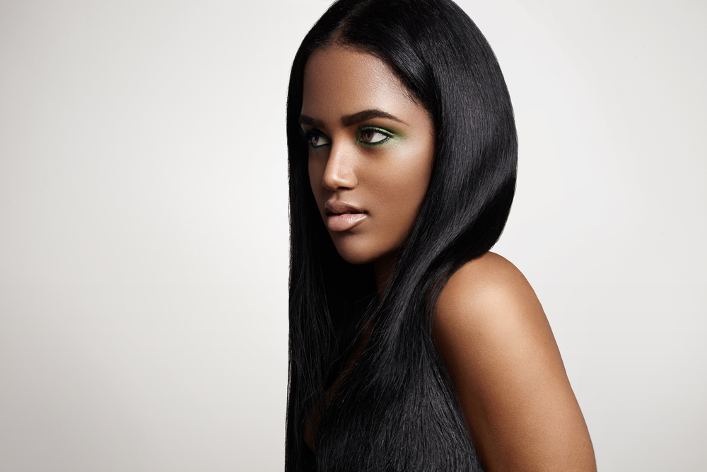 Beautiful black woman with straight hair.