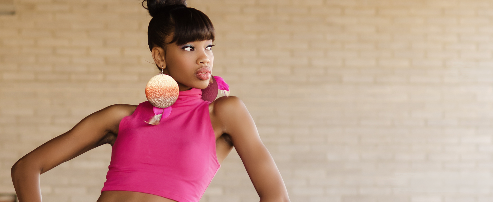 Girl in pink top posing