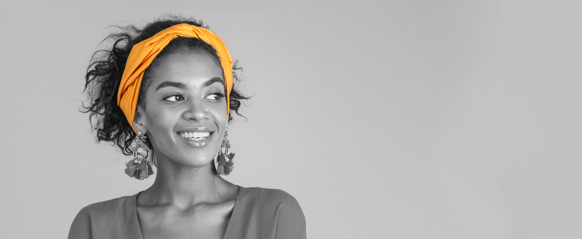 Black and white photo of a woman with a orange headband.